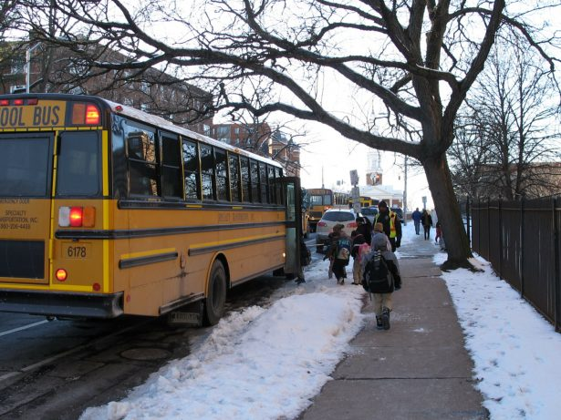 students board bus in cold