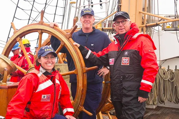 (R to L) Ron Holland aboard the U.S. Coast Guard Cutter Eagle in 2017, with Capt. Matt Meilstrup and Lt. Cmdr. Brooke Millard. (courtesy of Ron Holland Design)