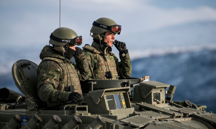 Spanish soldiers in a tank during an exercise to capture an airfield as part of the Trident Juncture 2018, a NATO-led military exercise, near the town of Oppdal, Norway, on Nov. 1, 2018 (JONATHAN NACKSTRAND/AFP/Getty Images)