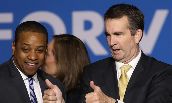 Gov.-elect Ralph Northam (R) and Lt. Gov.-elect Justin Fairfax greet supporters at an election night rally Nov. 7, 2017 in Fairfax, Virginia. (Win McNamee/Getty Images)