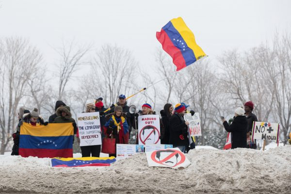 Protestors against the regime of Nicolas Maduro in Venezuela show their support for Juan Guaido outside the 10th Lima Group in Ottawa on Feb. 24, 2019. (Lars Hagberg/AFP/Getty Images)