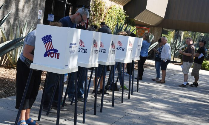 People vote at outdoor booths during early voting for the midterm elections in Pasadena, Calif., on Nov. 3, 2018. (Mark Ralston/AFP/Getty Images)