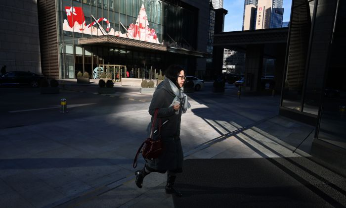 China's economy maybe worse than it presents. Half of Chinese didn't receive year-end bonuses before new year, some even were laid off. (GREG BAKER/AFP/Getty Images)
