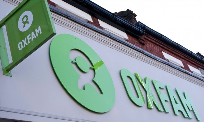 'Oxfam' signage is pictured outside a high street branch of an Oxfam charity shop in south London on February 17, 2018. JUSTIN TALLIS/AFP/Getty Images