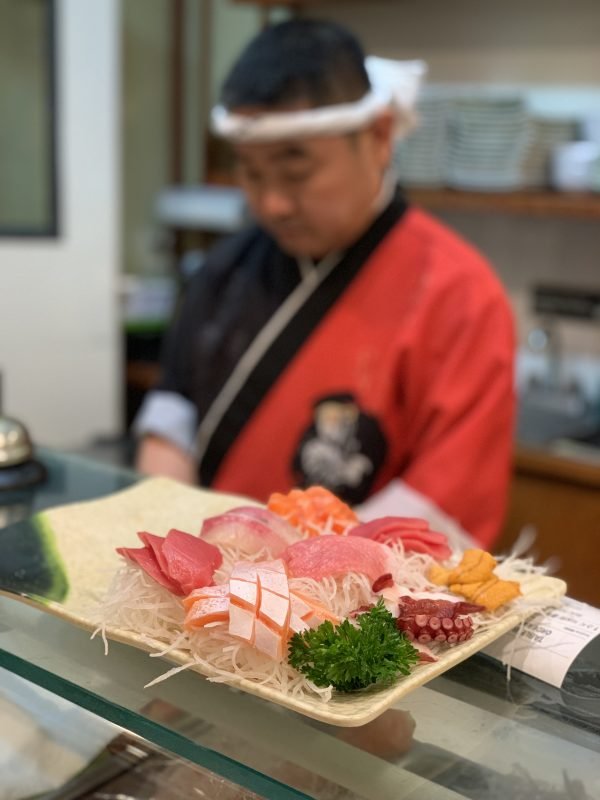 Sashimi platter on sushi counter from Golden Sushi