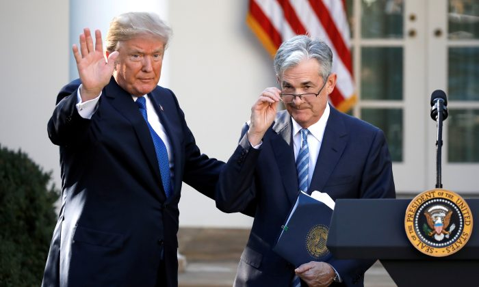 FILE—President Donald Trump gestures with Jerome Powell, his nominee to become chairman of the Federal Reserve at the White House, on Nov. 2, 2017. (Carlos Barria/Reuters)