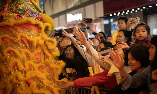 Asia Welcomes Year of the Pig With Banquets, Temple Visits