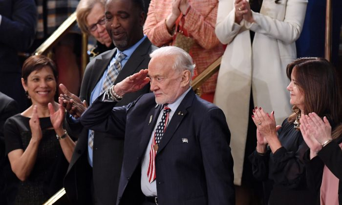 Former NASA astronaut Buzz Aldrin salutes as he is recognized by US President Donald Trump during the State of the Union address at the US Capitol on Feb. 5, 2019. (Saul Loeb/AFP/Getty Images)