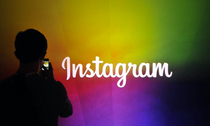 An Instagram employee takes a video in Menlo Park, California, on June 20, 2013.  (Josh Edelson/AFP/Getty Images)