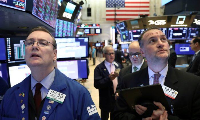 Traders work on the floor of the New York Stock Exchange (NYSE) in N.Y. on Feb. 4, 2019. (Brendan McDermid/Reuters)
