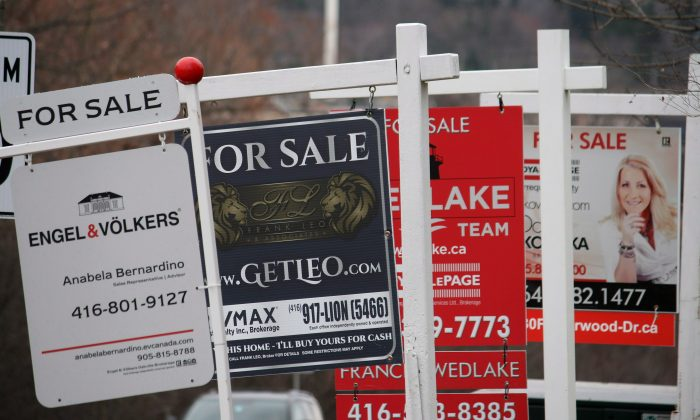 Real estate for sale signs are shown in Oakville, Ont. on Dec.1, 2018. The number of homes sold inTorontoand the surrounding area fell in 2018, along with the number of new listings hitting the market, as homebuyers and sellers grappled with a new reality of higher interest rates and stricter mortgage rules. (The Canadian Press/Richard Buchan)