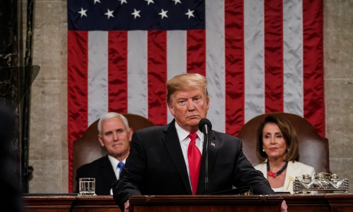 President Donald Trump, with Speaker Nancy Pelosi and Vice President Mike Pence looking on, delivers the State of the Union address in the chamber of the U.S. House of Representatives at the U.S. Capitol Building in Washington on Feb. 5, 2019. (Doug Mills-Pool/Getty Images)