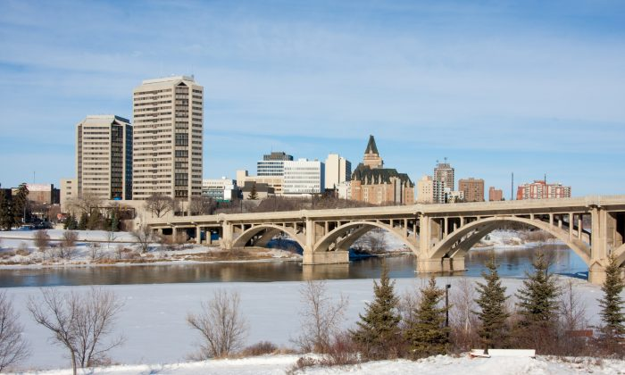 A view of the Broadway Bridge and downtown Saskatoon, Canada on a sunny day in winter. (Fotolia)