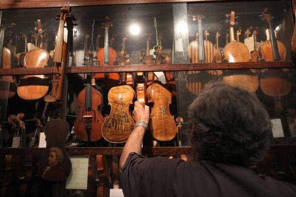 Israeli violin maker Amnon Weinstein shows his violin collection