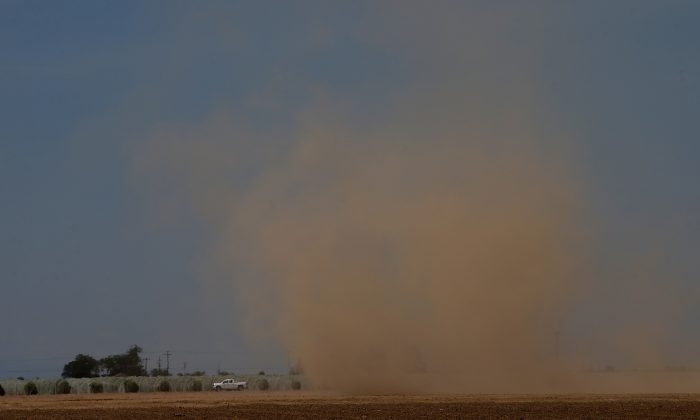 Dust over an empty field in Madera, Calif. on April 24, 2015. (Photo by Justin Sullivan/Getty Images)