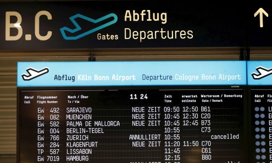 A departure board at Cologne-Bonn airport announces delays in Cologne, Germany, on Jan. 31, 2019. (Wolfgang Rattay/File Photo/Reuters)