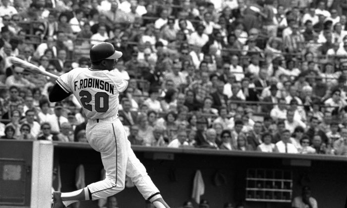 Baltimore Orioles' Frank Robinson at bat. Hall of Famer Frank Robinson, the first black manager in Major League Baseball and the only player to win the MVP award in both leagues. (AP)