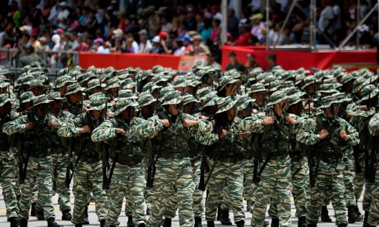Members of the Bolivarian militia take part in a military parade to celebrate the 207th anniversary of the Venezuelan Independence in Caracas on July 5, 2018. (FEDERICO PARRA/AFP/Getty Images)
