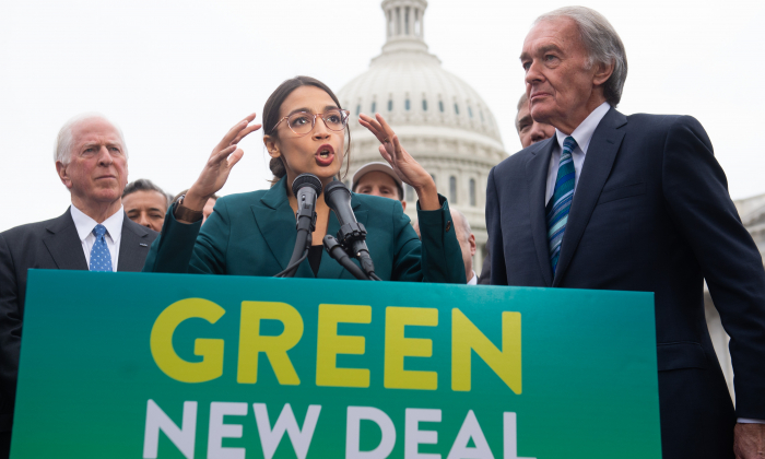 US Representative Alexandria Ocasio-Cortez, Democrat of New York, and US Senator Ed Markey (R), Democrat of Massachusetts, speak during a press conference to announce Green New Deal legislation to promote clean energy programs outside the US Capitol in Washington on Feb. 7, 2019. (Saul Loeb/AFP/Getty Images)