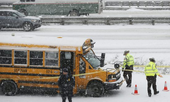 A person of interest was taken into custody after a school bus driver was shot where Interstate 35W and 94 run together near downtown Minneapolis, on Feb. 5, 2019. (Richard Tsong-Taatarii/Star Tribune via AP)