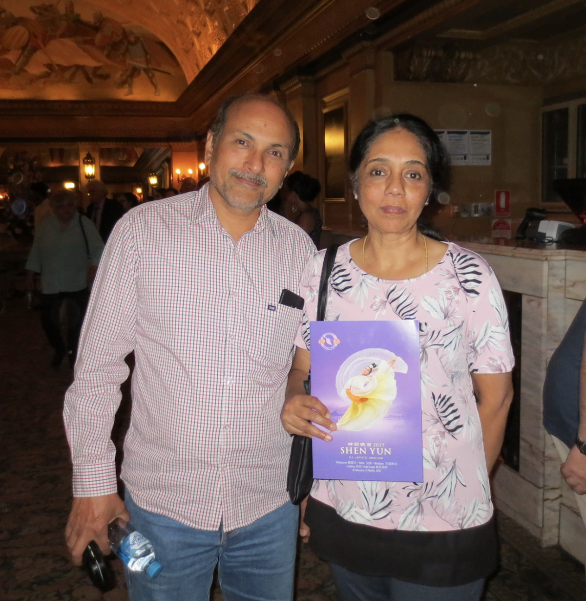 (L) Gopal Swaminathan, owner of GK Chemsource, with (R) Lakshmi at the Regent Theatre in Melbourne, Australia on Feb. 8, 2019. (Lucy Liu/Epoch Times)