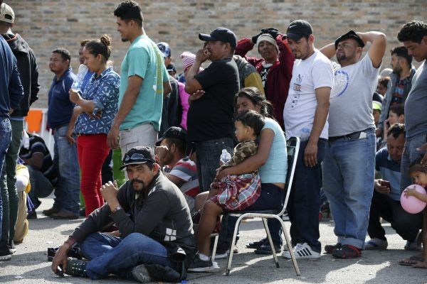 immigrants line up to register