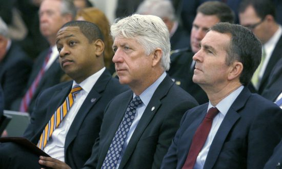 From left, Lt. Governor-elect Justin Fairfax, Attorney General-elect Mark Herring and Governor-elect Ralph Northam listen as Virginia Governor Terry McAuliffe addresses a joint meeting of the House and Senate money committees at the Pocahontas Building in Richmond, Va. on Dec. 18, 2017 (Bob Brown/Richmond Times-Dispatch via AP)