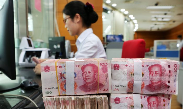 100-yuan notes sit at a bank in Nantong City, in eastern China's Jiangsu Province on July 23, 2018. (AFP/Getty Images)