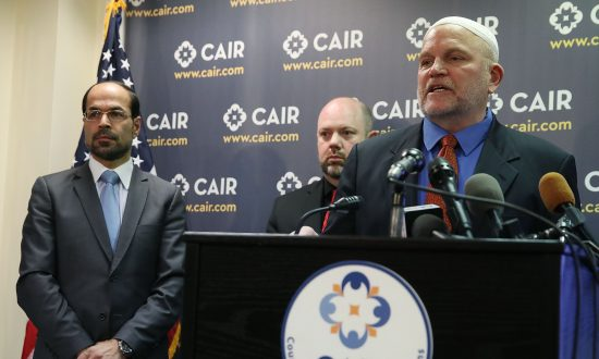 Ibrahim Hooper (R), Corey Saylor (C), and Gadeir Abbas (L), of the Council on American-Islamic Relations (CAIR), speak to the media about the executive order U.S. President Donald Trump signed today about middle east travel, on March 6, 2017 in Washington, DC.  Mark Wilson/Getty Images