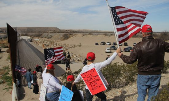 Supporters of increased security along the U.S.-Mexico border make a human wall to demonstrate their support for a border wall, at Sunland Park, N.M., Feb. 9, 2019. (Hericka Martinez/AFP/Getty Images)