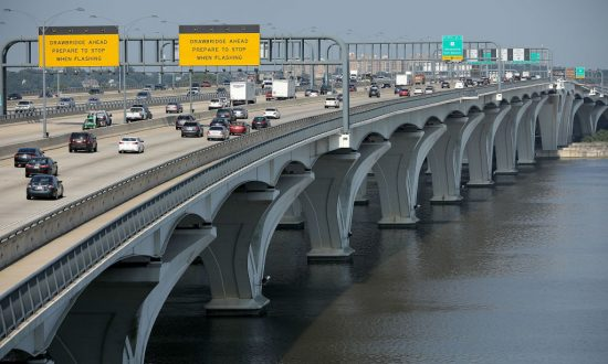 Automobile traffic moves across the Woodrow Wilson Bridge along the Capitol Beltway during rush hour in Fort Washington, Md., on July 3, 2018. Chip Somodevilla/Getty Images