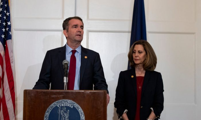 Virginia Governor Ralph Northam, flanked by his wife Pam, speaks with reporters at a press conference at the Governor's mansion in Richmond, Virginia, on Feb. 2, 2019. (Alex Edelman/Getty Images)