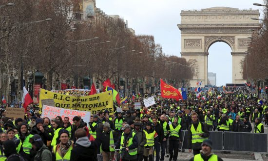 Protesters in a demonstration by the yellow vest movement in Paris, on Feb. 9, 2019. (Gonzalo Fuentes/Reuters)