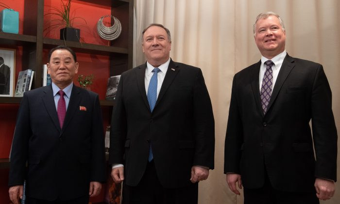 U.S. Secretary of State Mike Pompeo (C) and U.S. Special Representative for North Korea Stephen Biegun (R) stand with North Korean Vice-Chairman Kim Yong-chol prior to a meeting in Washington on Jan. 18, 2019. (SAUL LOEB/AFP/Getty Images)