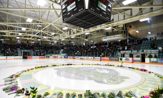 Flowers lie on the ice as people gather for a vigil at the Elgar Petersen Arena, home of the Humboldt Broncos, on April 8, 2018. Saskatchewan's privacy commissioner has found eight people inappropriately gained access to electronic health records of 10 Humboldt Broncos team members in reports released Jan. 31, 2019. (Jonathan Hayward/Pool via REUTERS)