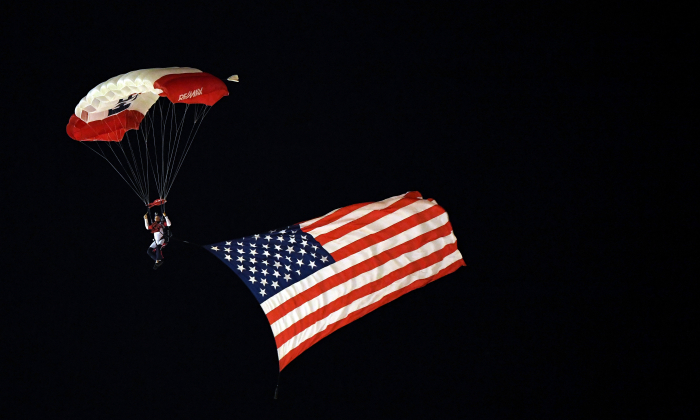 A skydiver flies with the American flag prior to the NASCAR Camping World Truck Series JAG Metals 350 at Texas Motor Speedway on Nov. 2, 2018 in Fort Worth, Texas. (Josh Hedges/Getty Images)