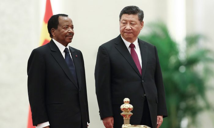 Chinese Leader Xi Jinping (L) welcomes Cameroon President Paul Biya in Beijing on March 22, 2018. The Chinese regime wrote off $78 million in debts from Cameroon but didn't report it.. (Lintao Zhang/Getty Images)