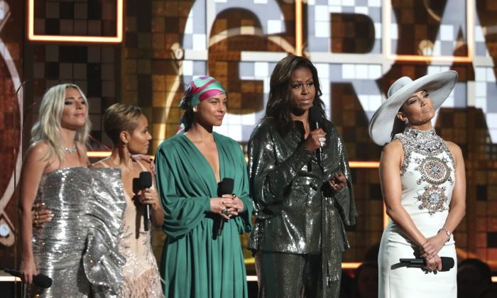 Lady Gaga, from left, Jada Pinkett Smith, Alicia Keys, Michelle Obama and Jennifer Lopez speak at the 61st annual Grammy Awards in Los Angeles on Feb. 10, 2019, (Matt Sayles/Invision/AP)