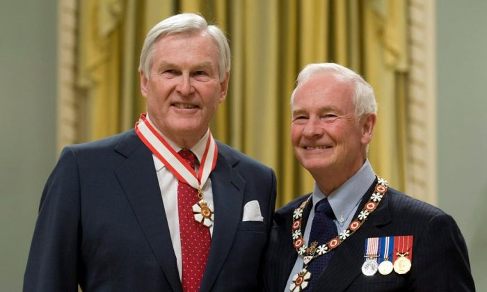 Governor General David Johnston (R) stands with Michael Wilson after investing him as a Companion of the Order of Canada during a ceremony at Rideau Hall in Ottawa on November 17, 2010. Wilson, a former politician, diplomat, and longtime mental health advocate, has died at 81. (The Canadian Press/Adrian Wyld)