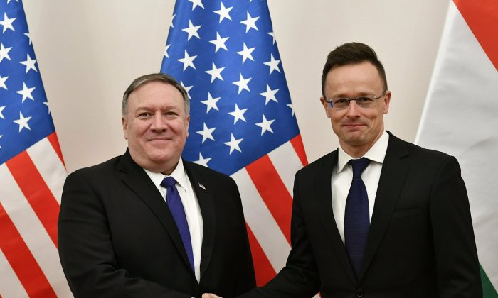Hungarian Minister of Foreign Affairs and Trade Peter Szijjarto, right, shakes hands with U.S. Secretary of State Mike Pompeo in the ministry in Budapest, Hungary, on Feb. 11, 2019. (Zsolt Szigetvary/MTI via AP)
