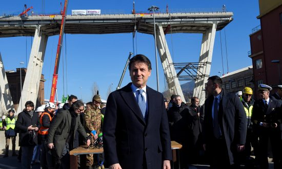 Italy's Prime Minister Giuseppe Conte arrives to visit the collapsed Morandi Bridge in Genoa, Italy, on Feb. 8, 2019. (Massimo Pinca/Reuters)