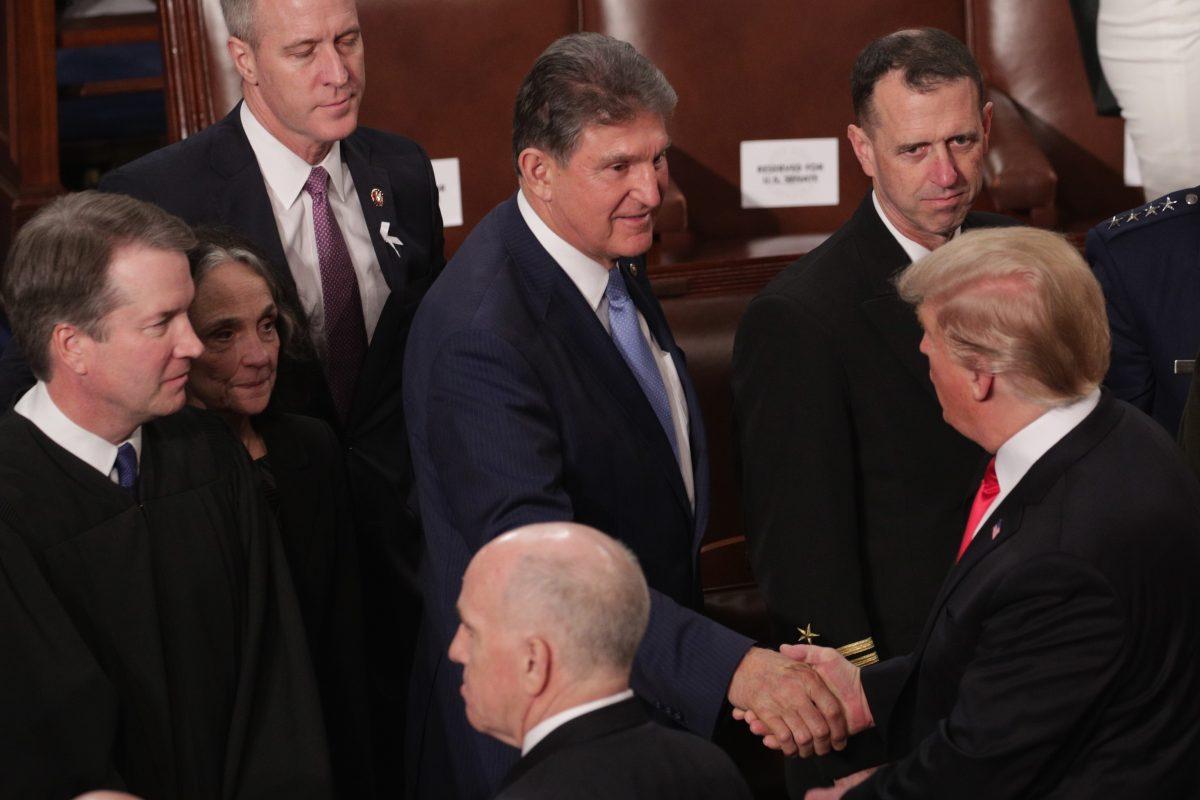 manchin shakes trump hand