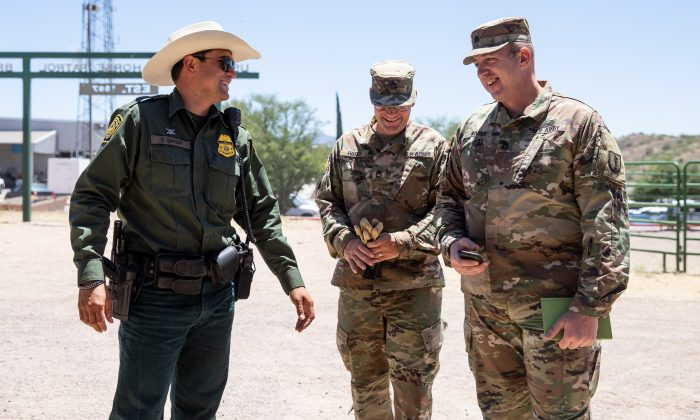 Border Patrol and National Guards at the horse stable area in the Tucson Sector Border Patrol headquarters in Nogales, Ariz., on May 23, 2018. (Samira Bouaou/The Epoch Times)