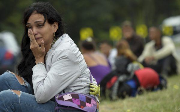 Venezuelan migrant Lulexis Gonzalez cries