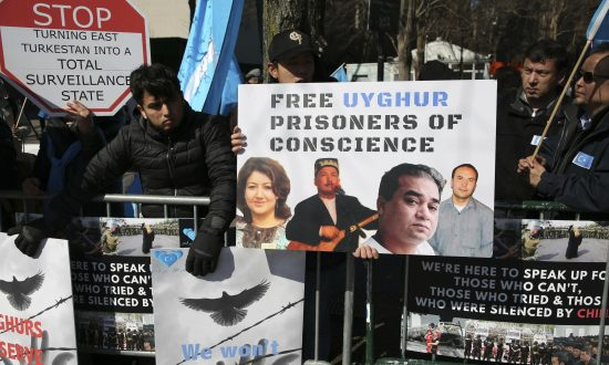 Uyghurs and their supporters rally across the street from United Nations headquarters in New York on March 15, 2018. Members of the Uyghur Muslim ethnic group are calling on the Chinese regime to post videos of their relatives who have disappeared into a vast system of internment camps. The campaign follows the release of a state media video showing famed Uyghur musician Abdurehim Heyit, who many believed had died in custody. (Seth Wenig/AP)