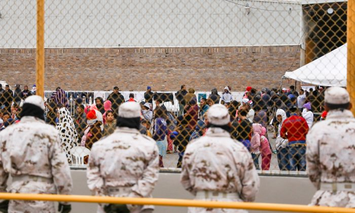Mexican police and military personnel guard the outside of an old factory where around 1,800 Central American migrants are being held in Piedras Negras, Mexico, on Feb. 8, 2019. (Charlotte Cuthbertson/The Epoch Times)