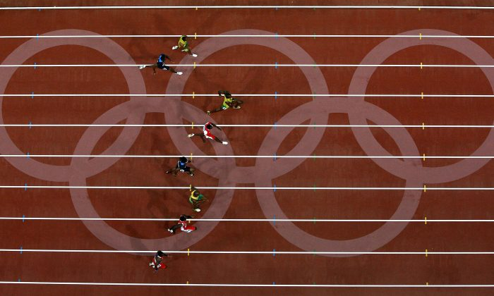 Usain Bolt of Jamaica leads the field on his way to winning the Men's 100 meter final in Beijing on Aug. 16, 2008, in Beijing, China. (Ezra Shaw/Getty Images)