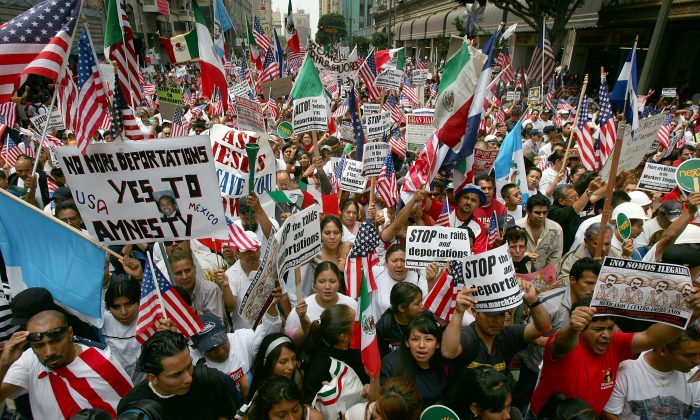 Thousands of demonstrators march through downtown to City Hall in one of several May Day marches and rallies in southern California and in at least 75 cities nationwide to press for immigrant and labor rights on May 1, 2007 in Los Angeles, California. David McNew/Getty Images