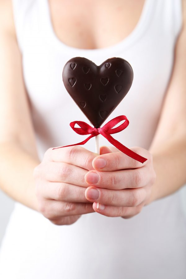 Woman holding a chocolate heart