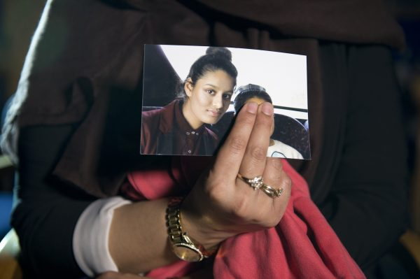 Renu, the eldest sister of Shamima Begum, holds her sister's photo during a media interview at New Scotland Yard in London on Feb. 22, 2015. (Laura Lean/PA Wire/Getty Images)